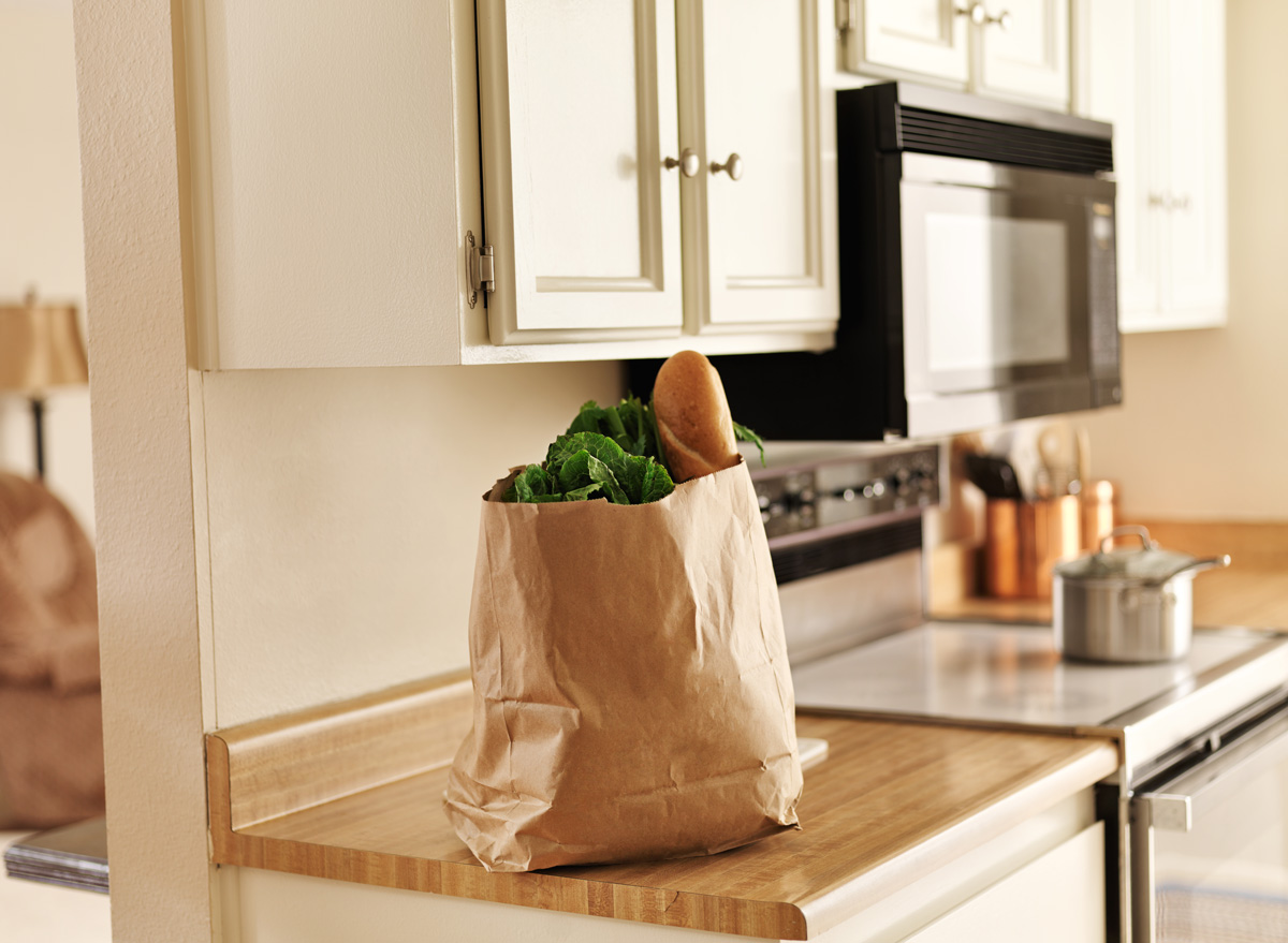 Groceries sitting in bag on kitchen counter