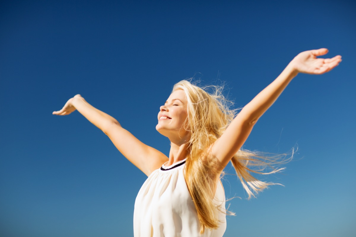 happy woman enjoying summer outdoors