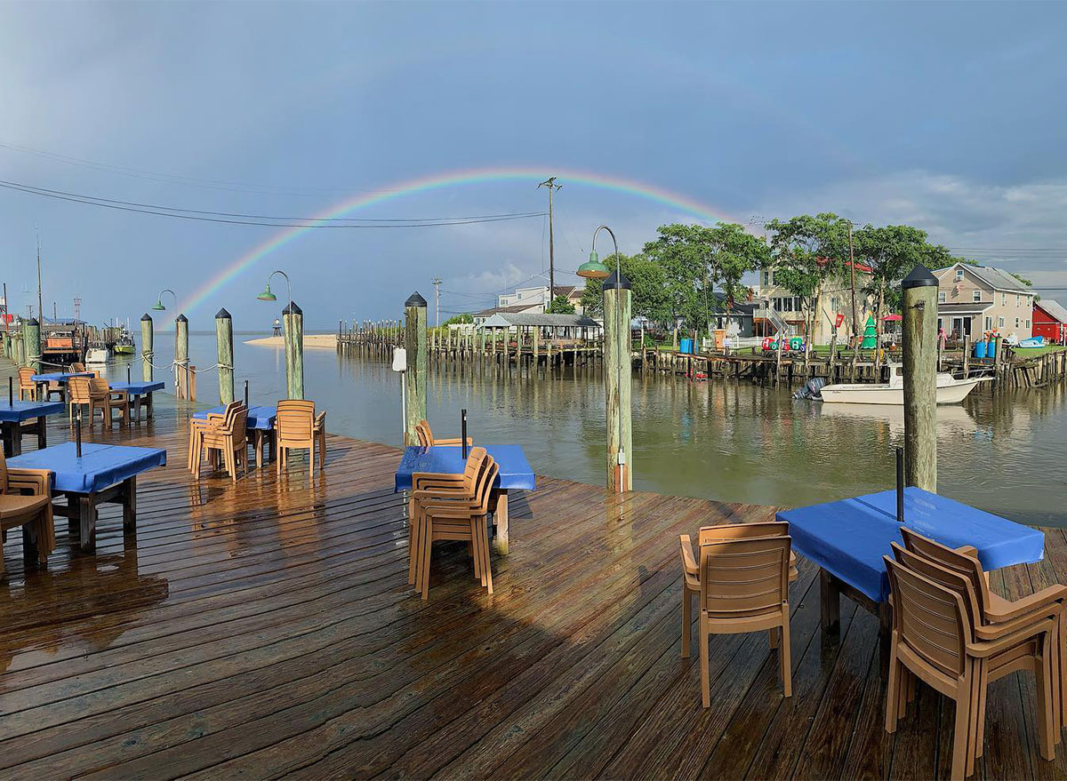 outdoor seating and rainbow at jps wharf in delaware