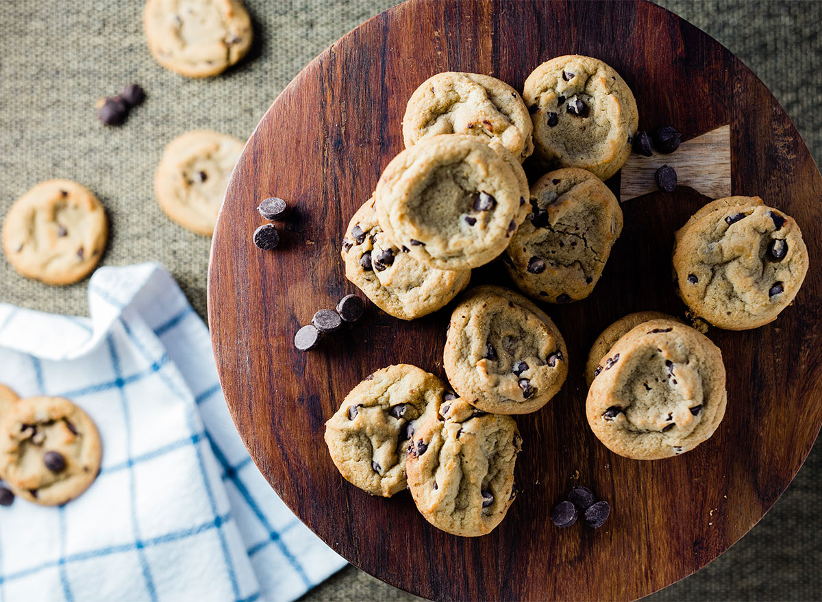 mini chocolate chip cookies on wood serving board
