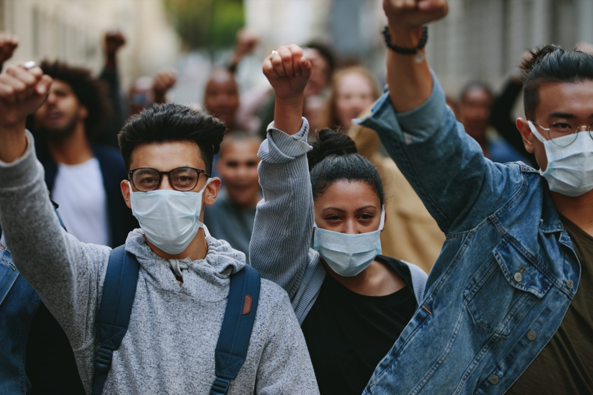 Group of people wearing face mask protesting and giving slogans in a ral