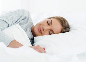 woman smiling while sleeping