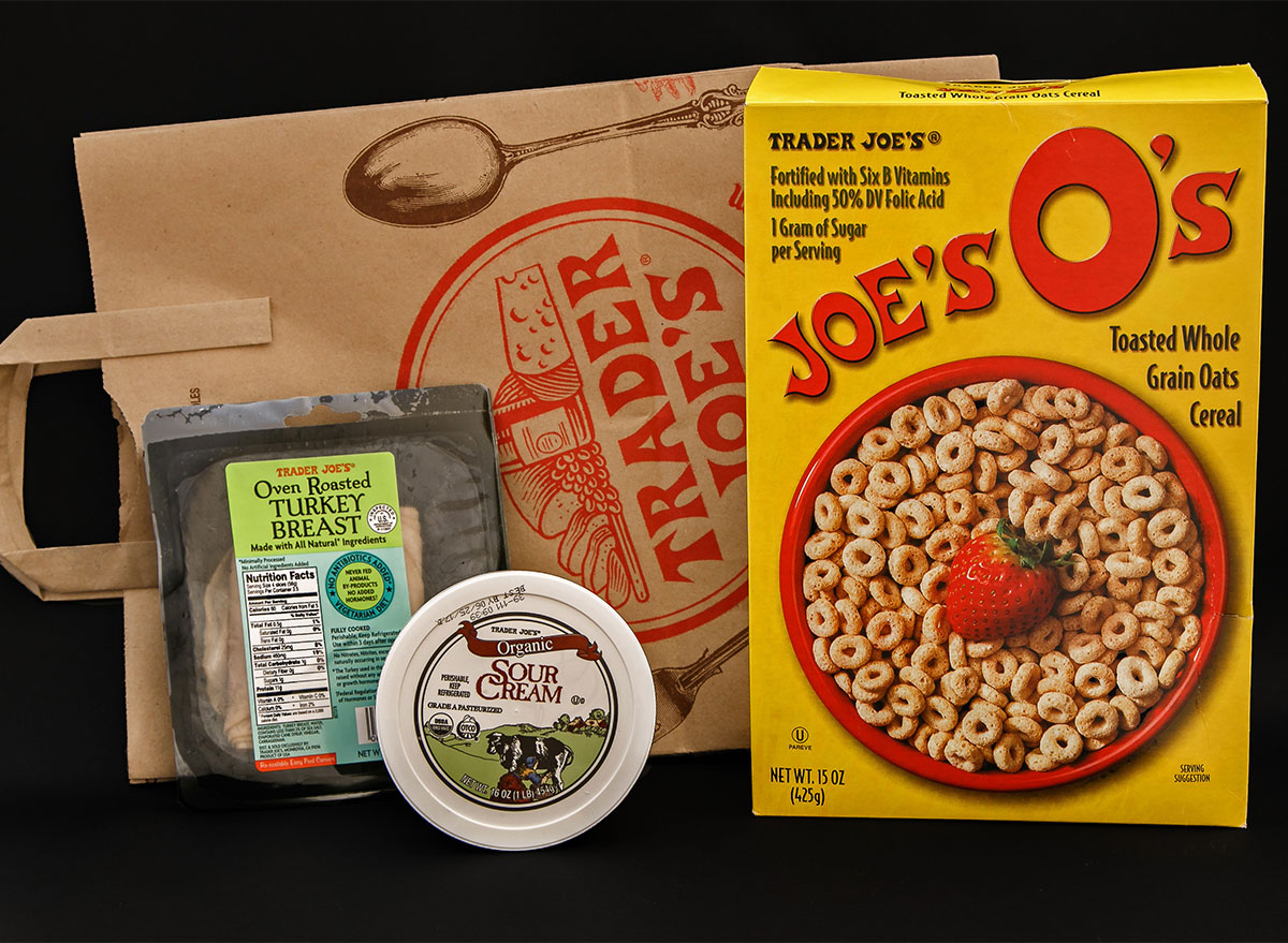 trader joes paper bag with box of cereal and turkey breast package