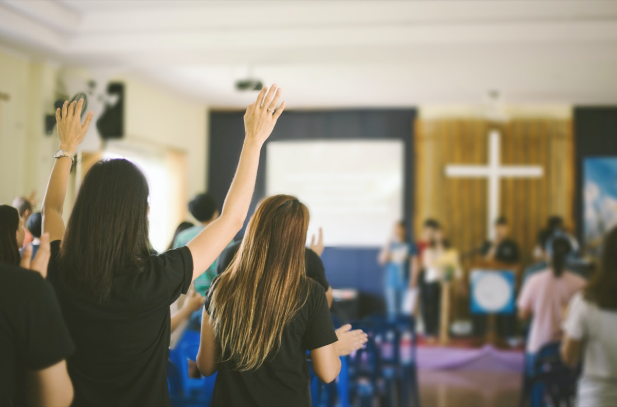 many people are worship to God and raised hands
