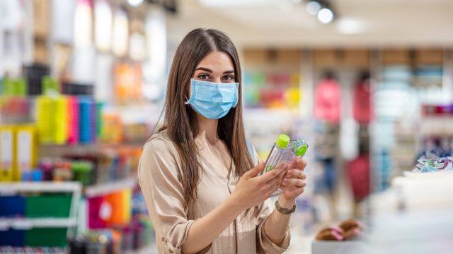 Woman face mask shopping
