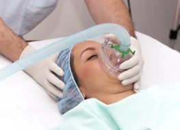 Woman patient receives anesthetic in hospital