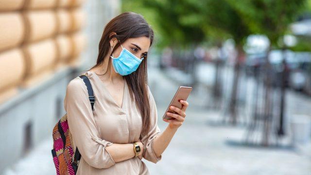 Woman phone face mask street outdoor text