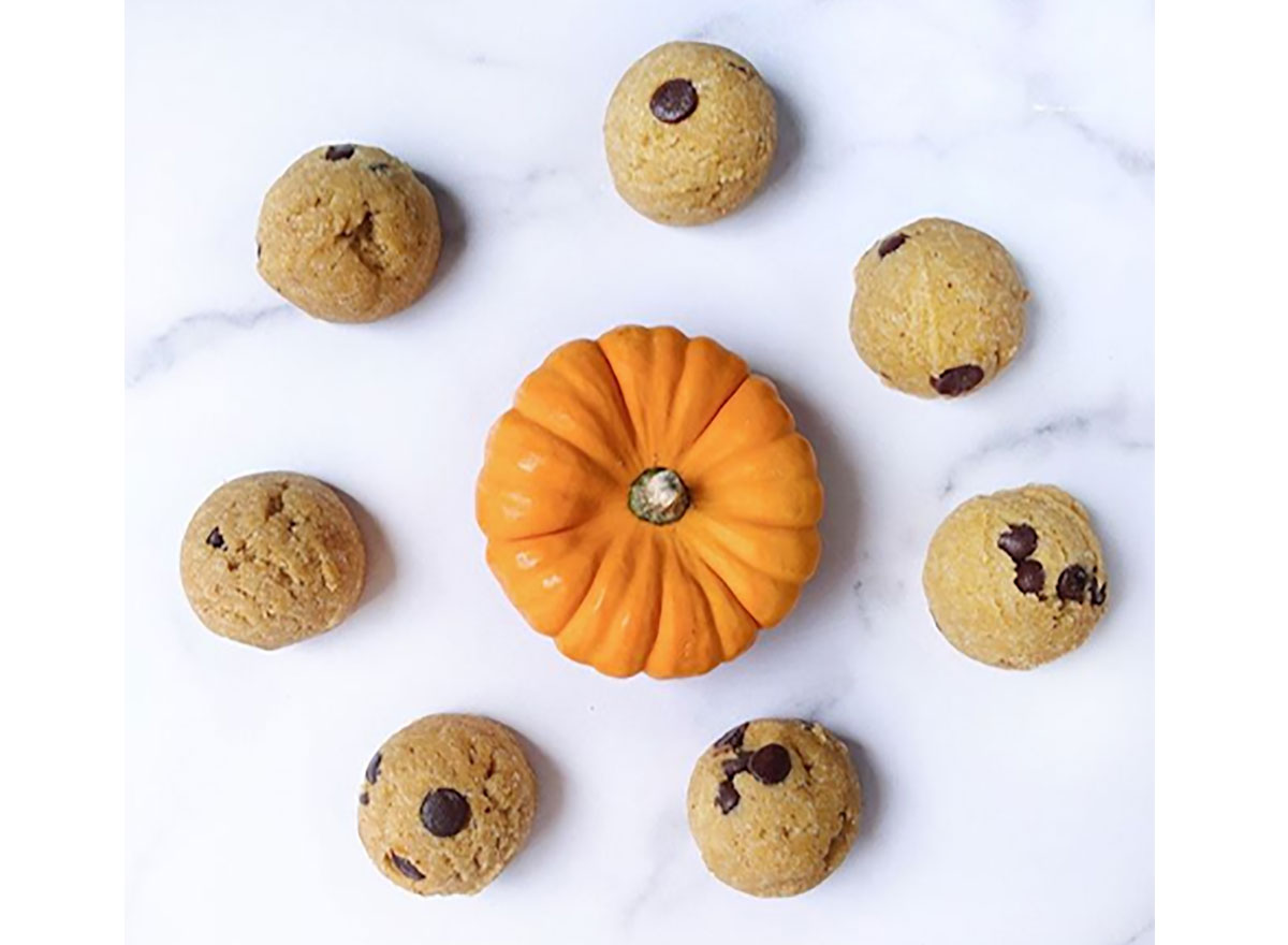 bougie bakes pumpkin spice cookie dough with mini pumpkin on marble board