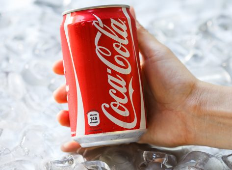 holding a can of coke