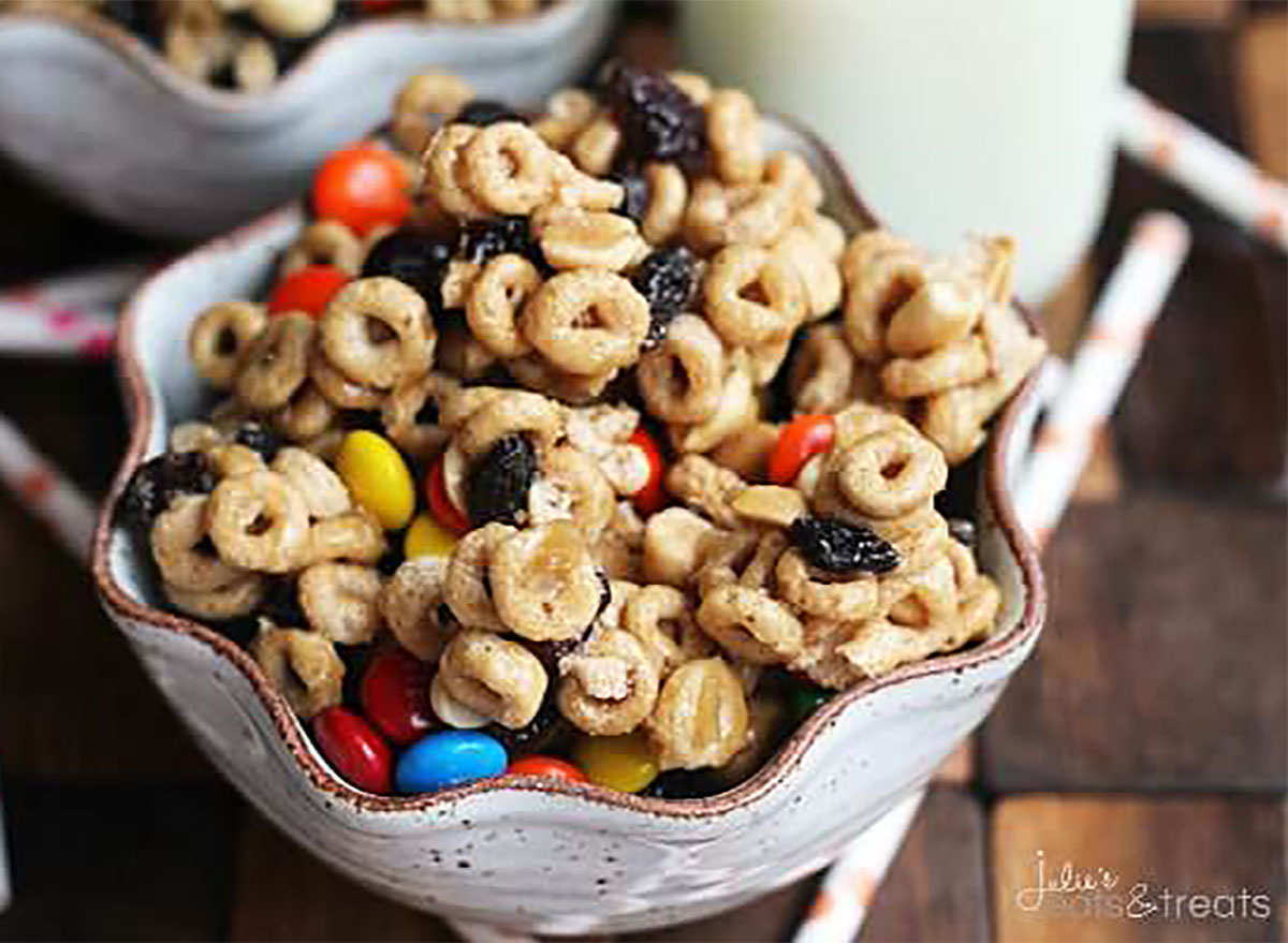 bowl of cheerios snack mix with mms and nuts