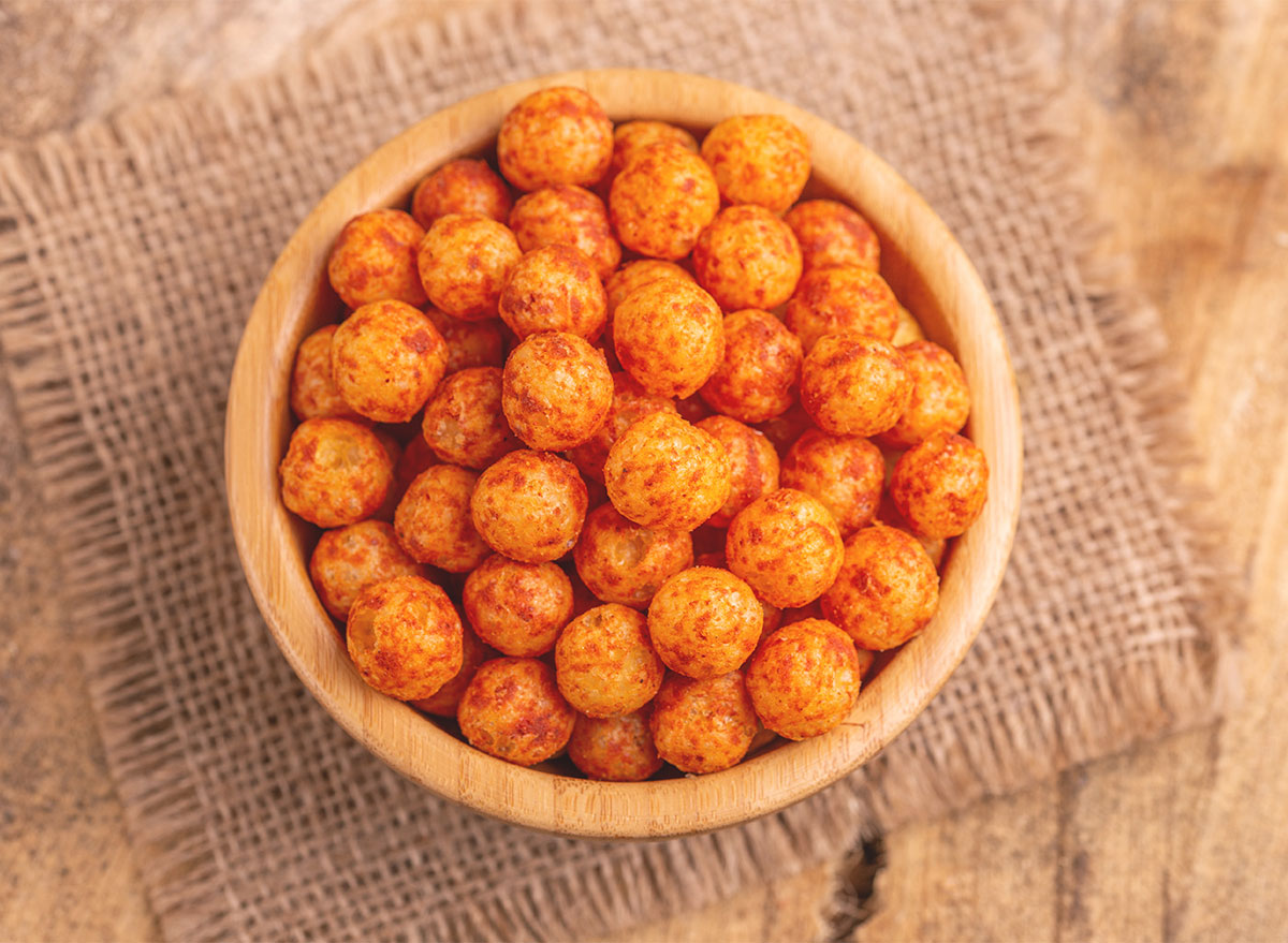 bowl of corn puffs balls with brown dust