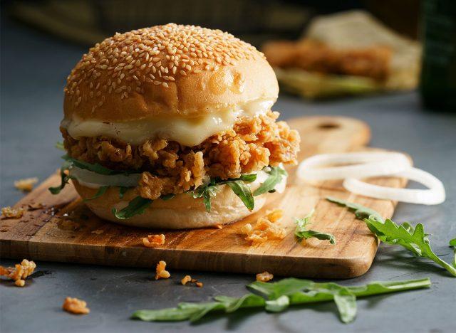 crispy chicken sandwich on serving board