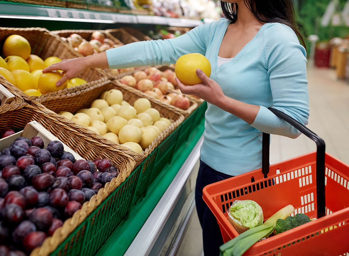 woman grocery shopping for fruit