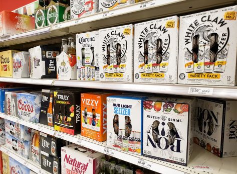 hard seltzer boxes in store aisle