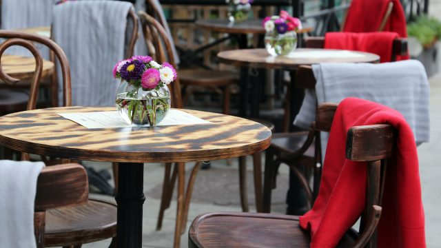 outdoor restaurant seating empty table with flowers