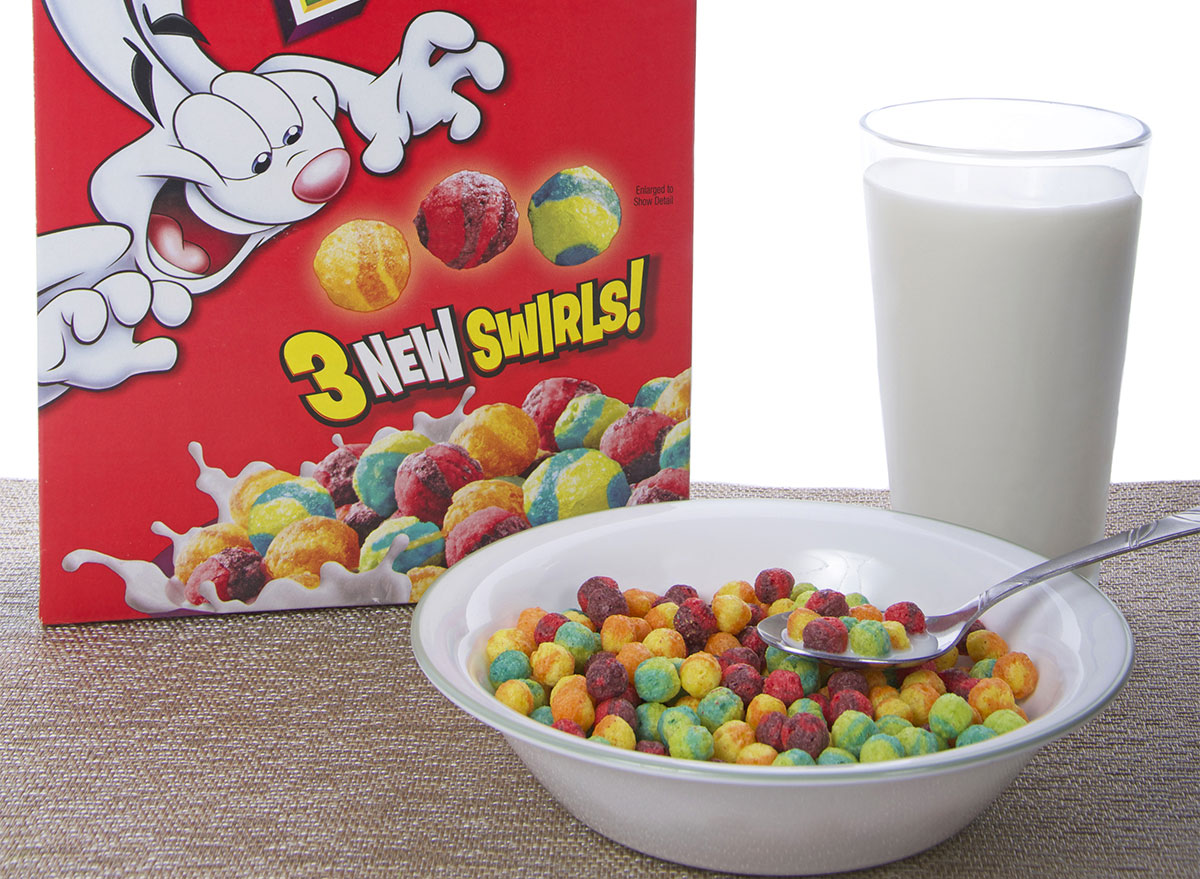 trix cereal box with bowl of cereal and glass of milk