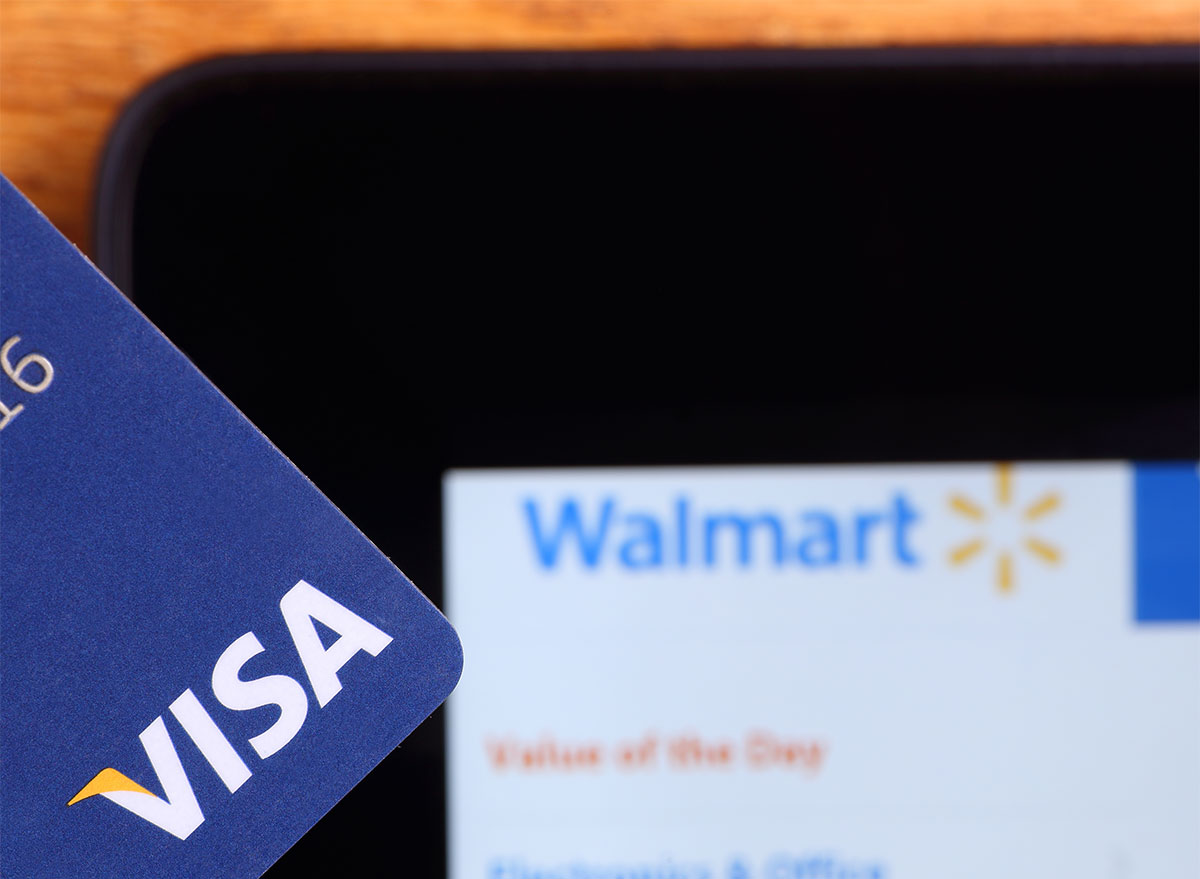 walmart website on smartphone with visa credit card