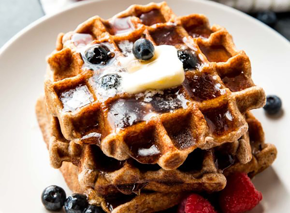 whole wheat waffles with butter and blueberries