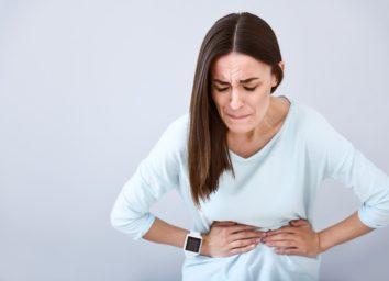 Sick woman having a stomach ache
