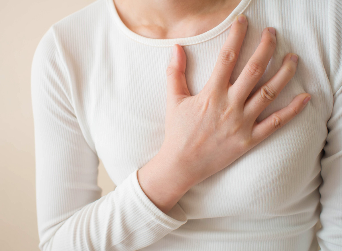 Woman experiencing heart burn and acid reflux from gastroesophageal disease