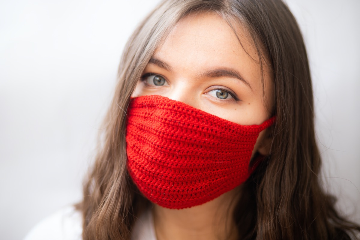 Woman wearing knitted face mask