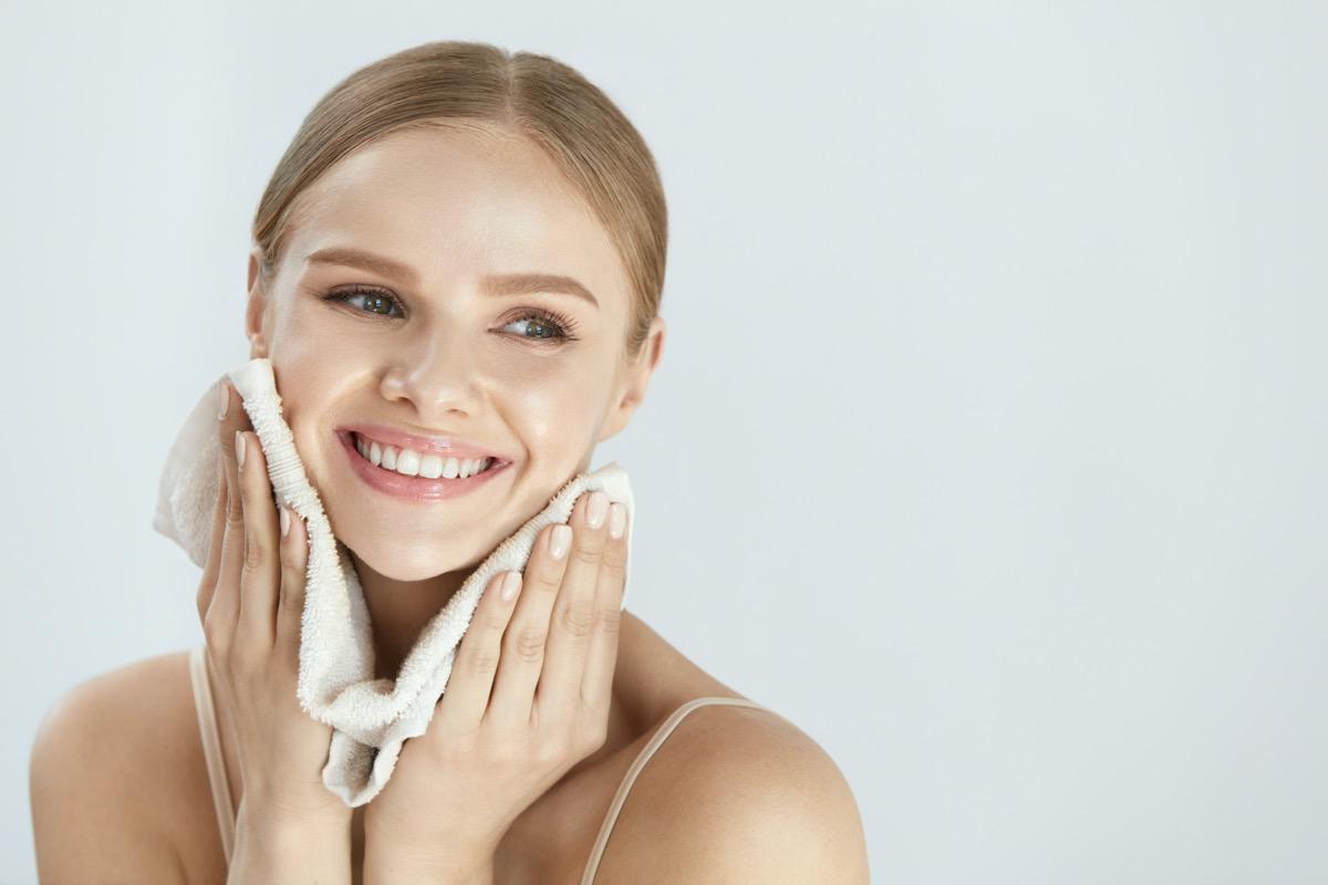 happy woman washing face