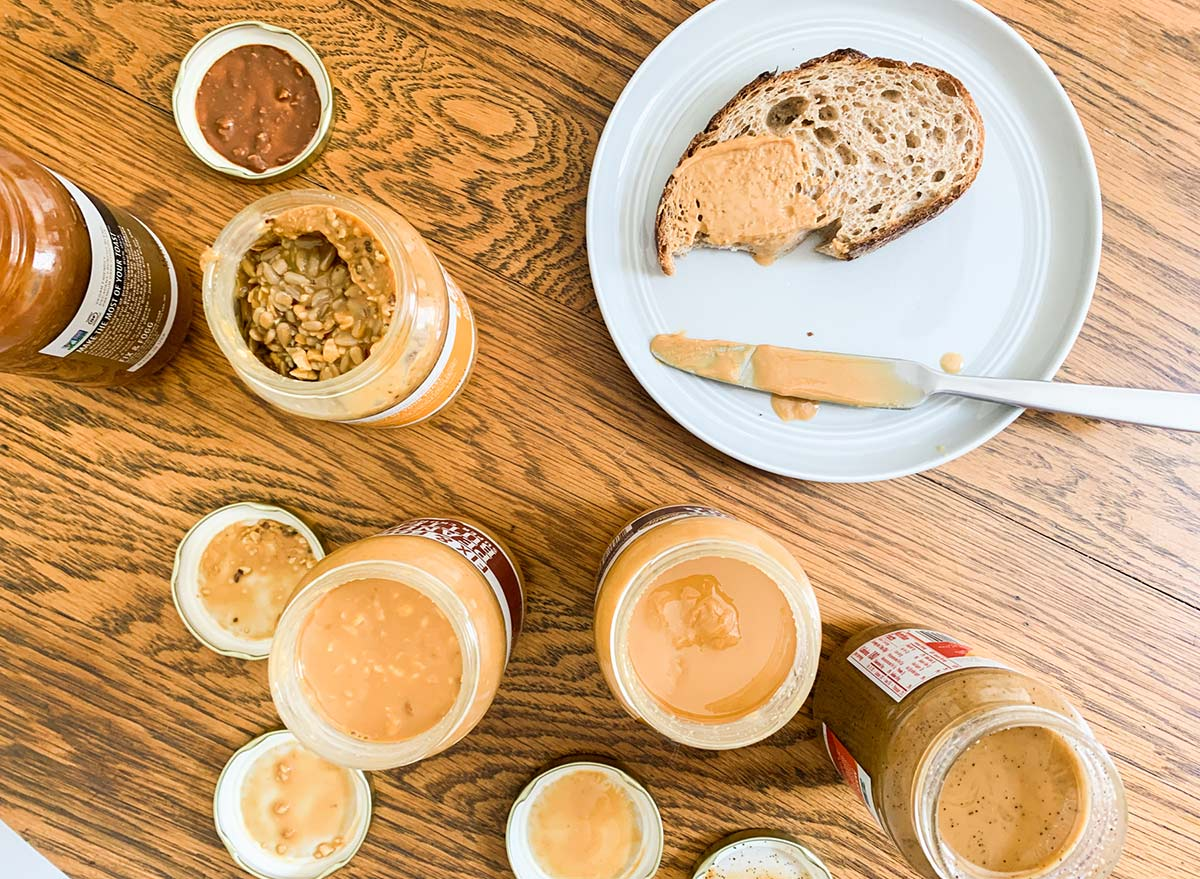 spreading different types of peanut butter on toast