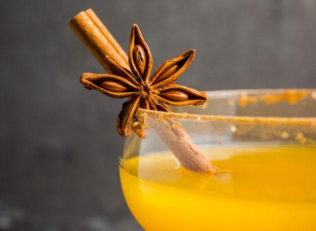 pumpkin spice cocktail with a cinnamon stick