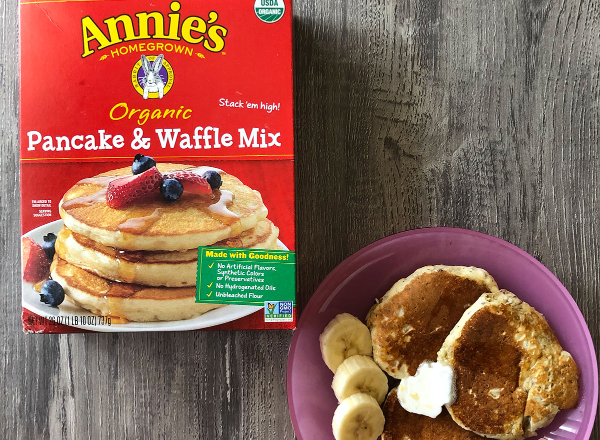box of annies pancake mix with plate of pancakes