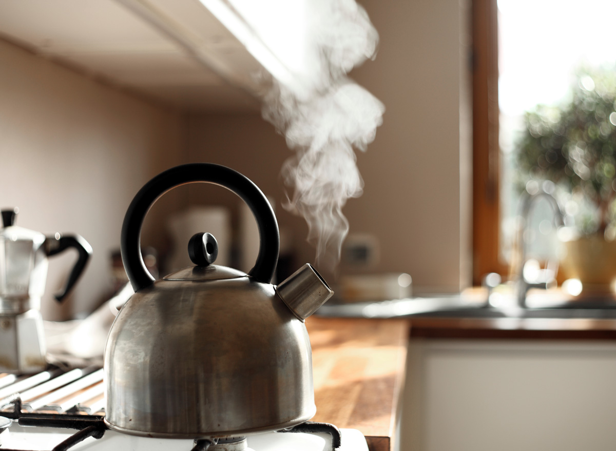 tea kettle boiling steaming on stove