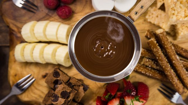 chocolate fondue with sliced strawberries and bananas