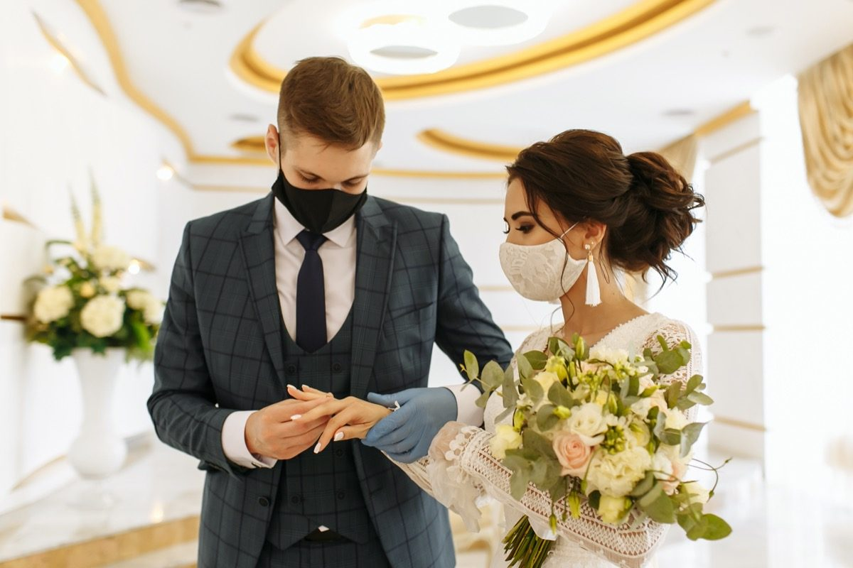 Masked bride and groom at a wedding ceremony