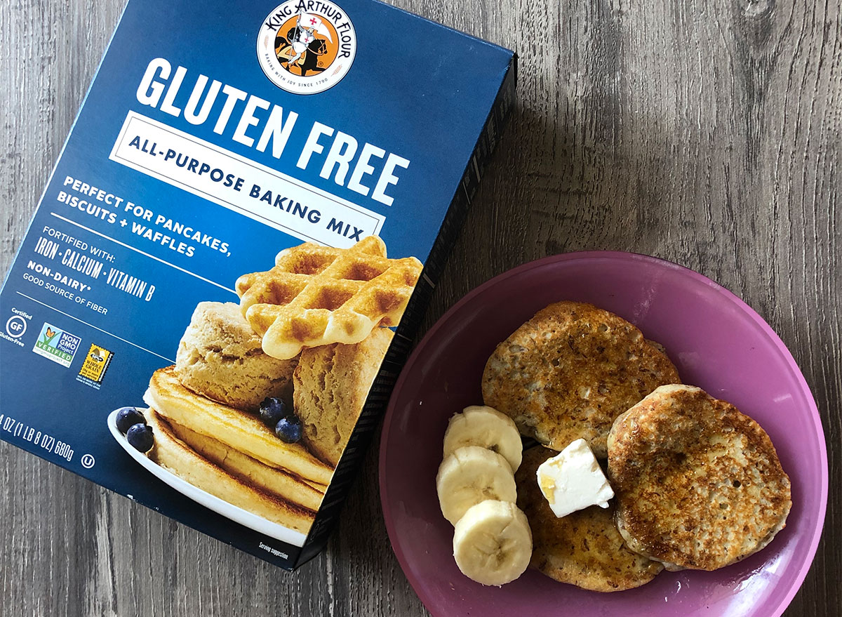 box of king arthur flour pancake mix with plate of pancakes