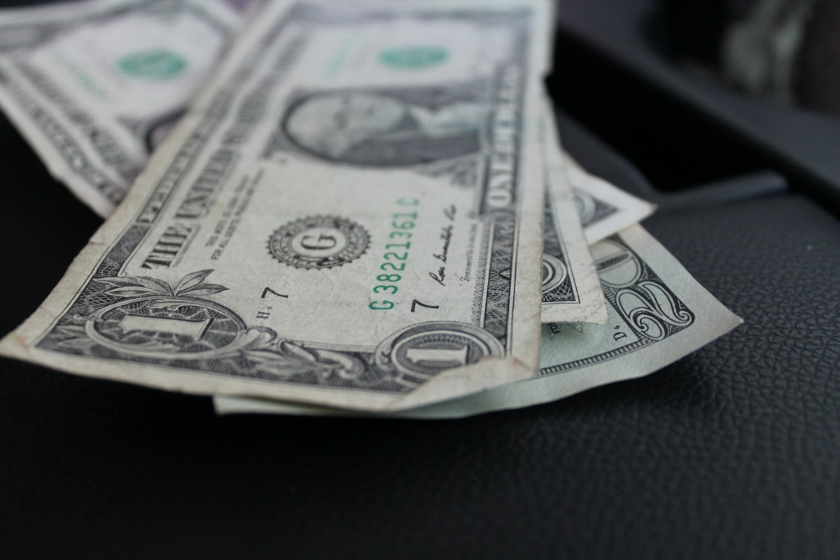 United States bills from side angle, one dollar and twenty dollar bills
