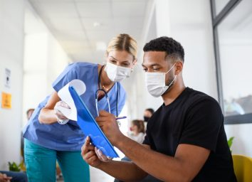 nurse and man with face masks