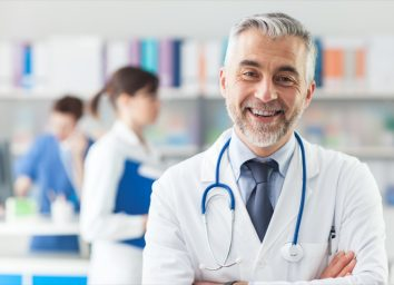 Smiling doctor posing with arms crossed in the office