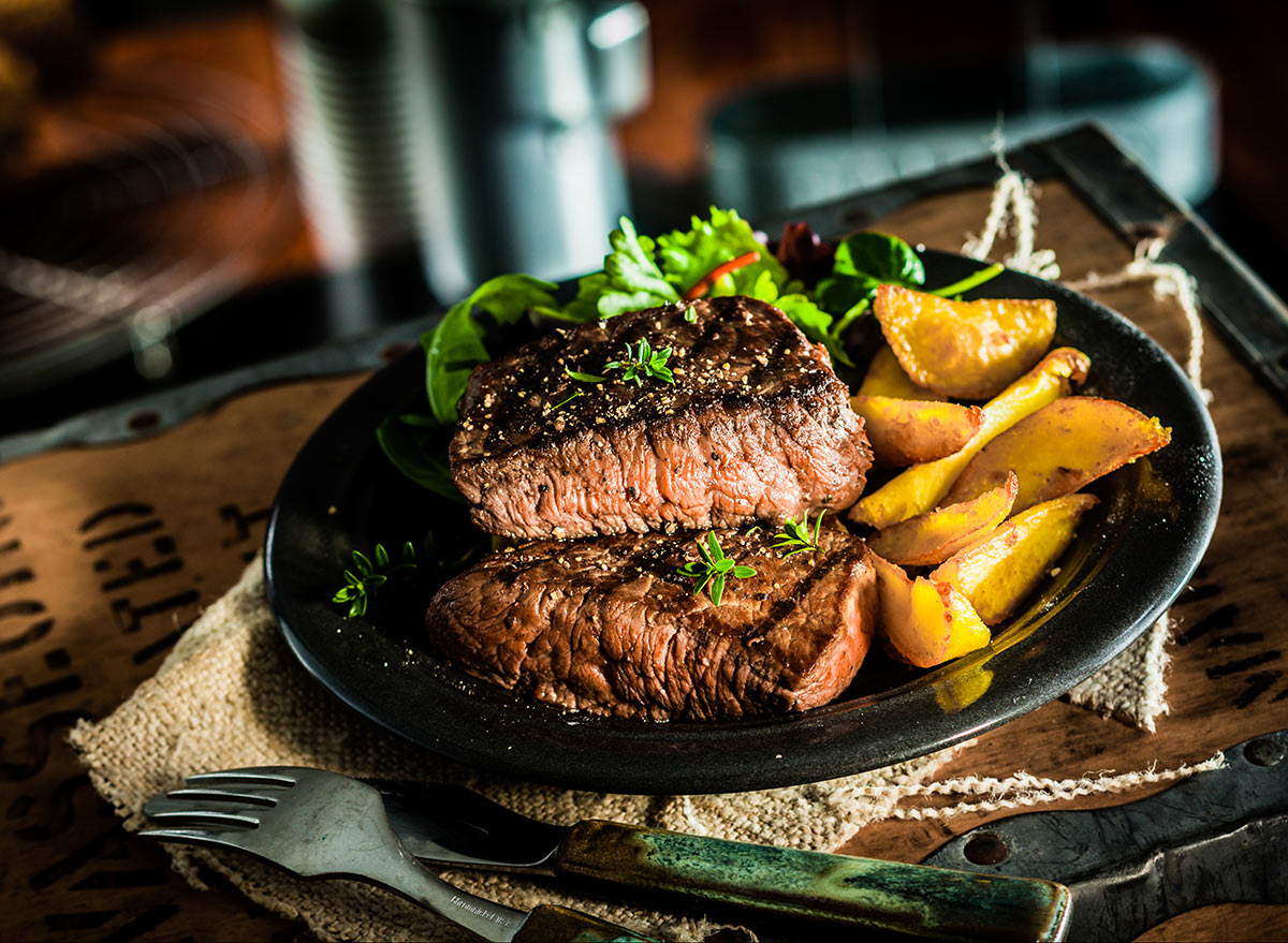 steak and potatoes on a plate