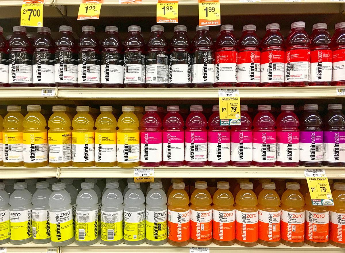 bottles of vitaminwater in store aisle