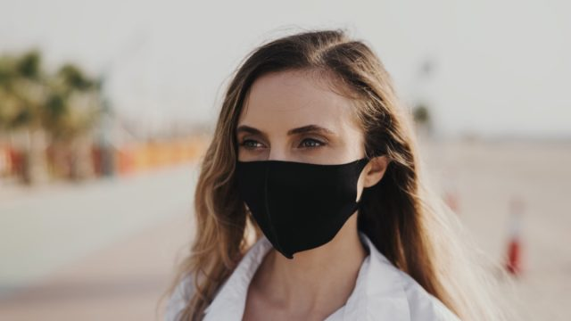 woman wearing black protective face mask