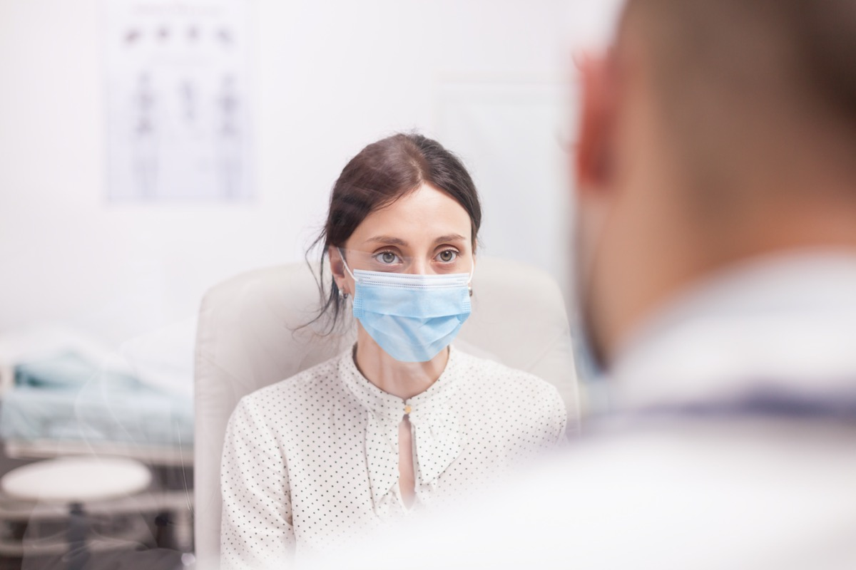 patient with protection mask against covid-19 during consultation with doctor in clinic office
