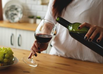 woman pouring glass of wine
