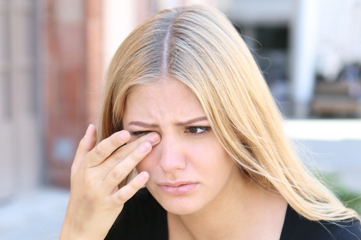 Woman with eye problems outside