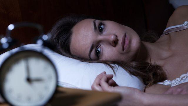 30-something woman having trouble sleeping