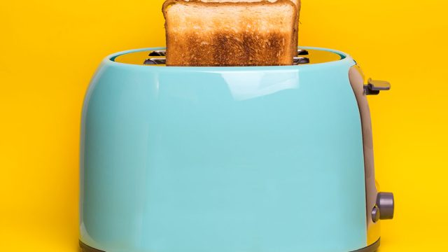 blue toaster with slices of toast