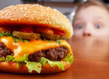 boy staring at a burger