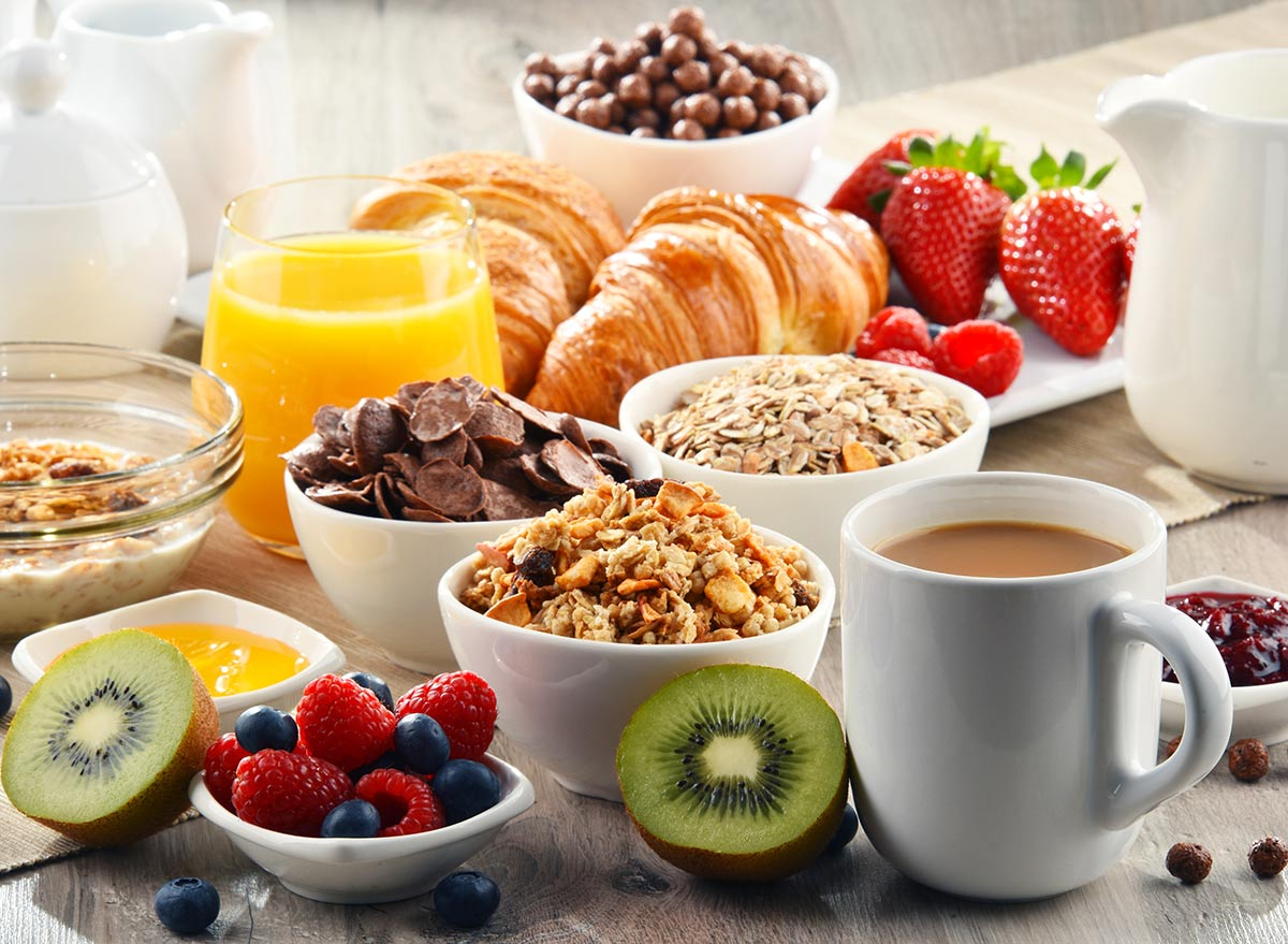 breakfast buffet with pastries fruit and cereal