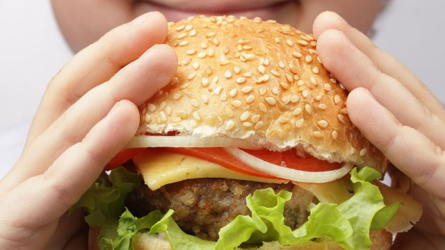 child eating burger