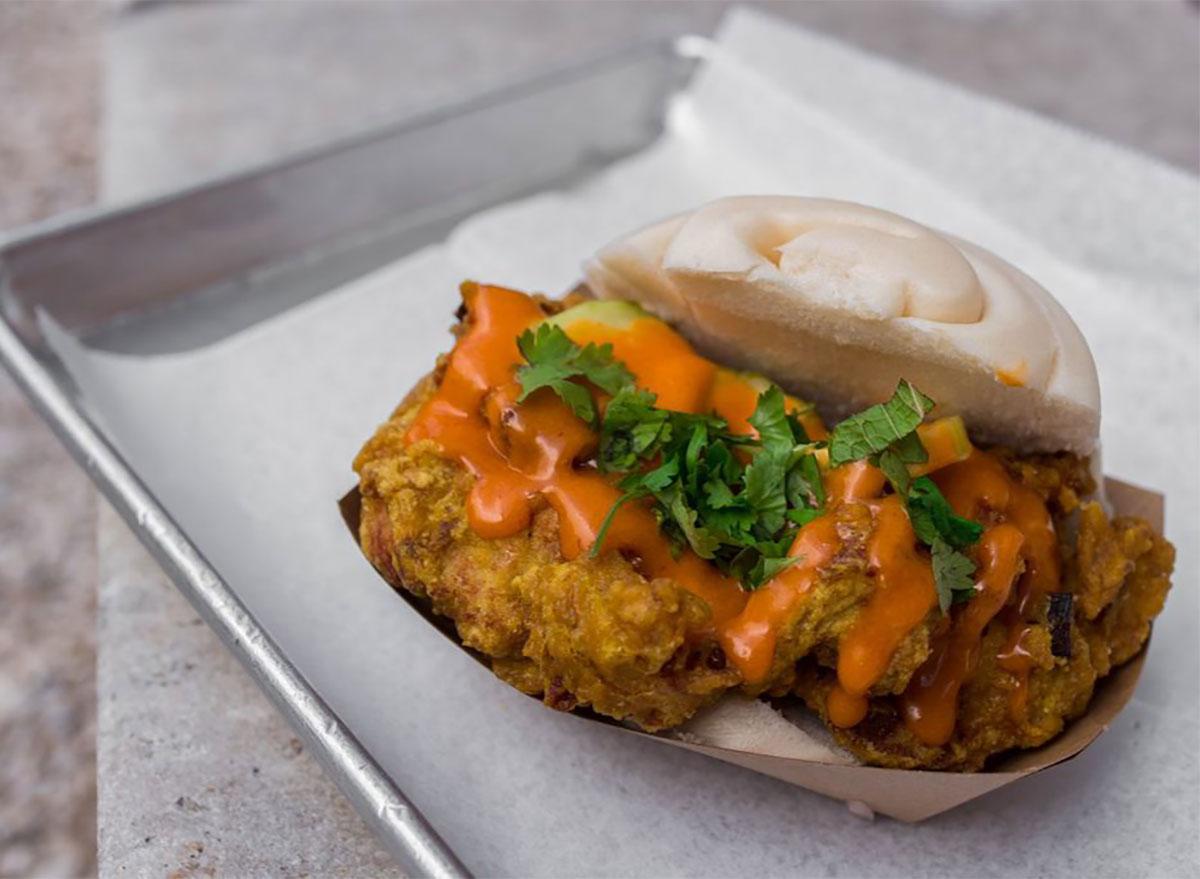 fried chicken steamed bun sandwich on tray