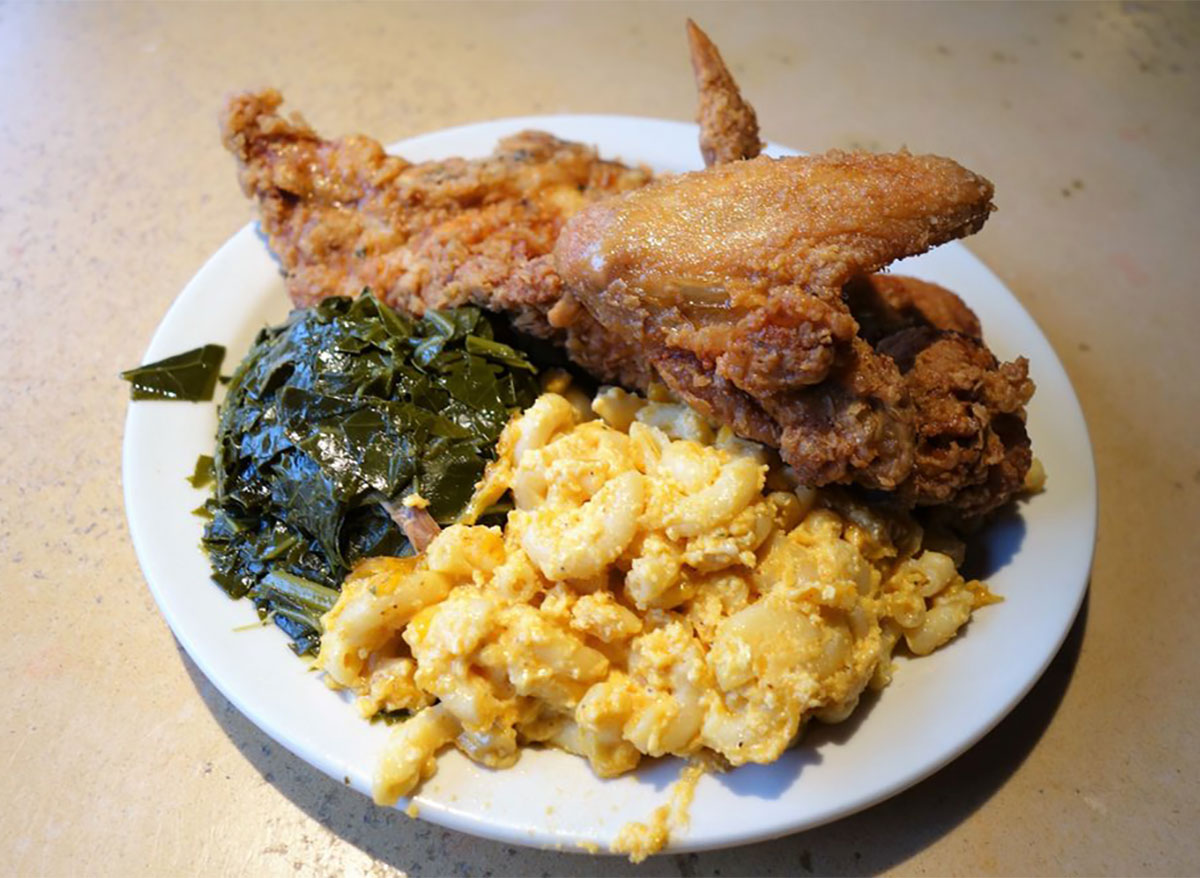 plate of fried chicken with mac and cheese and collard greens