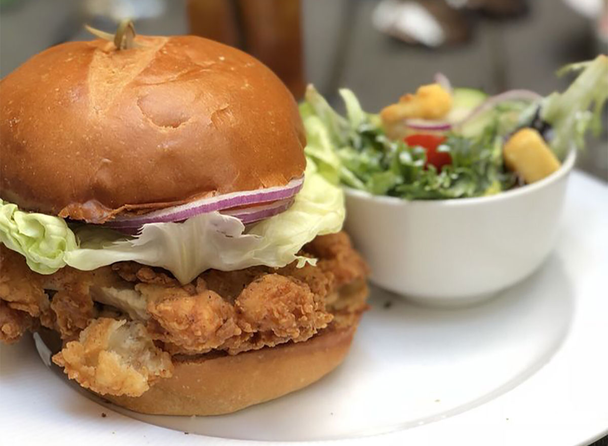 fried chicken sandwich with side salad